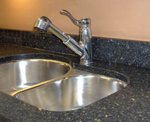 quartz countertop and stainless steel sink